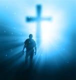 Sunbeams and cross. A man walking towards a cross with sunbeams Stock Photography