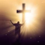 Sunbeams and cross. A man walking towards a cross with sunbeams Royalty Free Stock Image