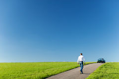 Man walking towards his cabriolet Royalty Free Stock Photography