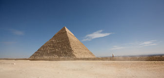 A man walking towards the Pyramid Stock Photos