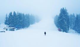 Man walking towards slope Royalty Free Stock Photos