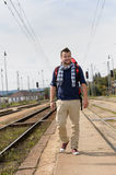 Man walking towards train station backpack travel Royalty Free Stock Photo