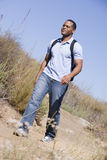 Man walking a trail in the countryside Royalty Free Stock Photography