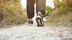 Man Walking on trail Track Outdoor Jogging exercise. In the morning stock image