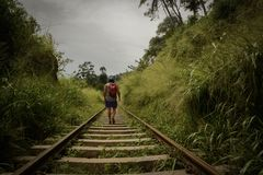 Man Walking In Train Railroad Stock Images