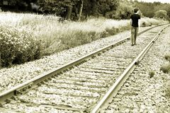 Man Walking On Train Tracks Stock Photos