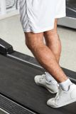 Man Walking On Treadmill In Health Club Stock Photo