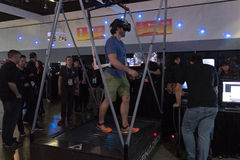 Man walking on the treadmill in virtual reality wearing futurist Stock Images