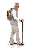 Man walking trekking poles Royalty Free Stock Photos