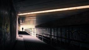 Man Walking Under Highway Bridge stock video