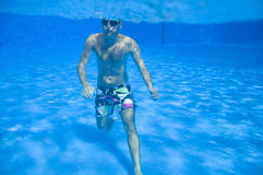 Man walking underwater Royalty Free Stock Images