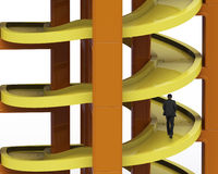 Man walking on unfinished spiral track in stacking blocks Stock Images