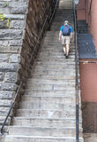 Man Walking Up a Flight of Stairs Royalty Free Stock Photography