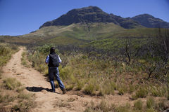 Man walking up a mountain. In south africa Royalty Free Stock Images