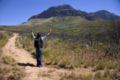 Man walking up a mountain. In south africa Stock Image