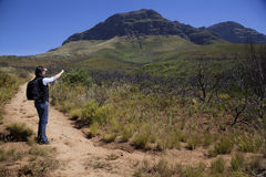 Man walking up a mountain. In south africa Stock Photo