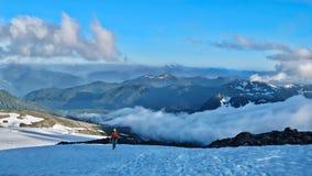 Man walking up the mountains. Easton Glacier. Railroad Grade Trail. Mount Baker. North Cascades National Park. Seattle. Washington. United States Stock Photography