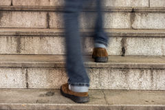 Man walking up an old stone staircase Royalty Free Stock Photos