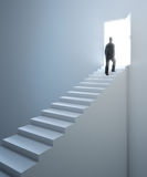 Man walking up the stairs Royalty Free Stock Image