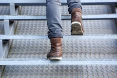 Man walking up stairs in boots Stock Photography