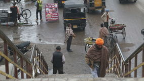 Man walking up the street stairs in Amritsar. stock footage