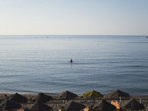Man walking water sea in Benalmadena beach Stock Image