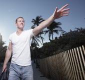 Man walking and waving stock images