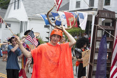 Man walking in the Wellfleet 4th of July Parade in Wellfleet, Massachusetts. Royalty Free Stock Images