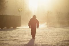 Man walking in winter fog Stock Images