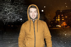Man walking  in the  winter park  by night Royalty Free Stock Photography