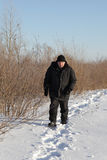 Man walking on winter path Royalty Free Stock Photography
