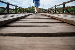 Man walking on a wooden bridge Royalty Free Stock Images