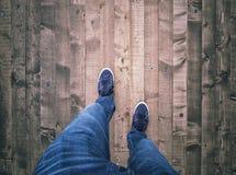 Man walking on wooden floor Stock Images