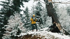 Man walks across cold winter forest covered with snow.  stock video