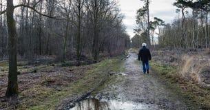 Man walks alone through a desolate area Stock Image