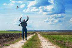 Man walks along a dirt road and enjoy the freedom Royalty Free Stock Image