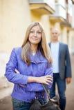 Man walks behind woman Stock Photo