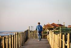 Man Walks on Boardwalk stock photo