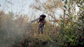 Man walks with camera in the wood. Man walks with an old camera in the wood stock video