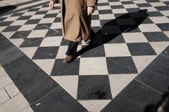 Man walks on checkered floor  pescara. Man walks on checkered floor in pescara Royalty Free Stock Photography