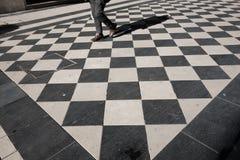 Man walks on checkered floor  pescara. Man walks on checkered floor in pescara Royalty Free Stock Image