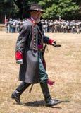 Man walks in Confederate officer uniform Stock Photo
