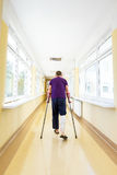 Man walks on crutches Royalty Free Stock Photography
