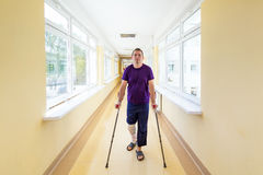 Man walks on crutches. After arthroscopic surgery Stock Photo
