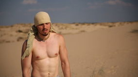 A man walks through the desert stock video footage