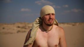 A man walks through the desert stock footage