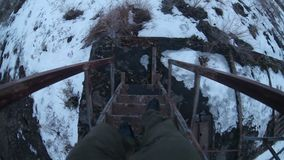 Man walks down the stairs an old abandoned railway stock video