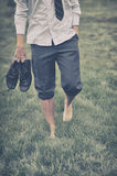 Man walks on grass Stock Images