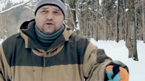 A man walks hard on a snowy road. HD 1920x1080p stock video footage