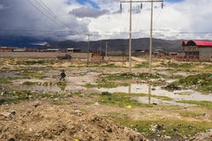 A Man Walks His Bicycle Across the Bolivian Countryside Royalty Free Stock Photos
